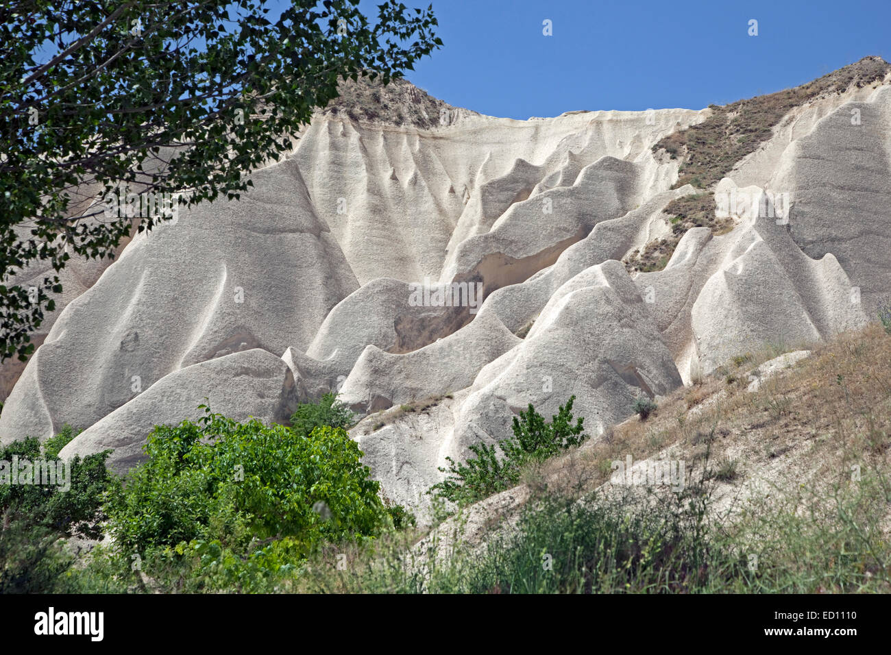 Gullies in water eroded white sandstone rock formations at Cappadocia in Central Anatolia, Turkey - Stock Image