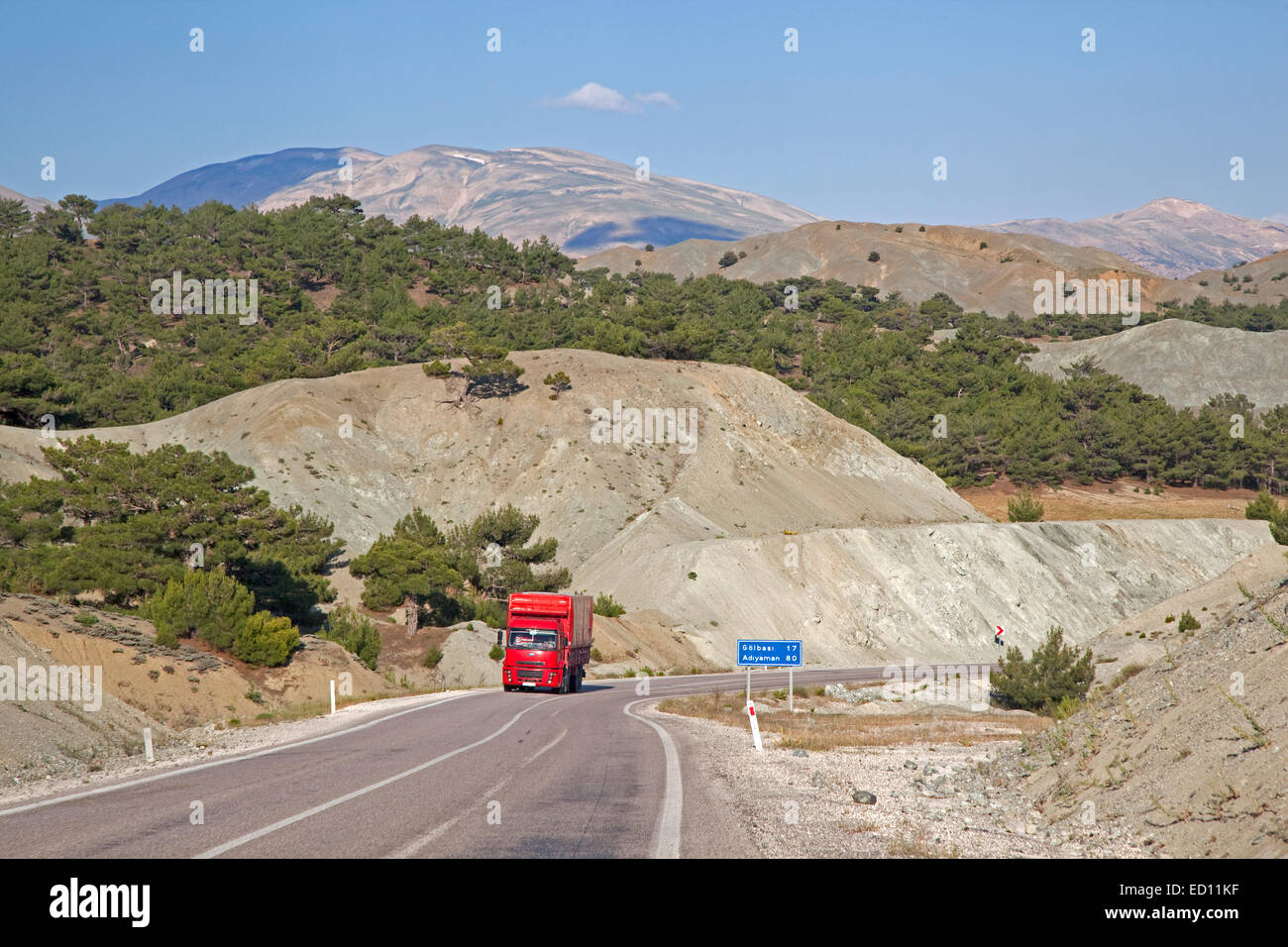 Red truck on motorway in Central Anatolia, Turkey - Stock Image