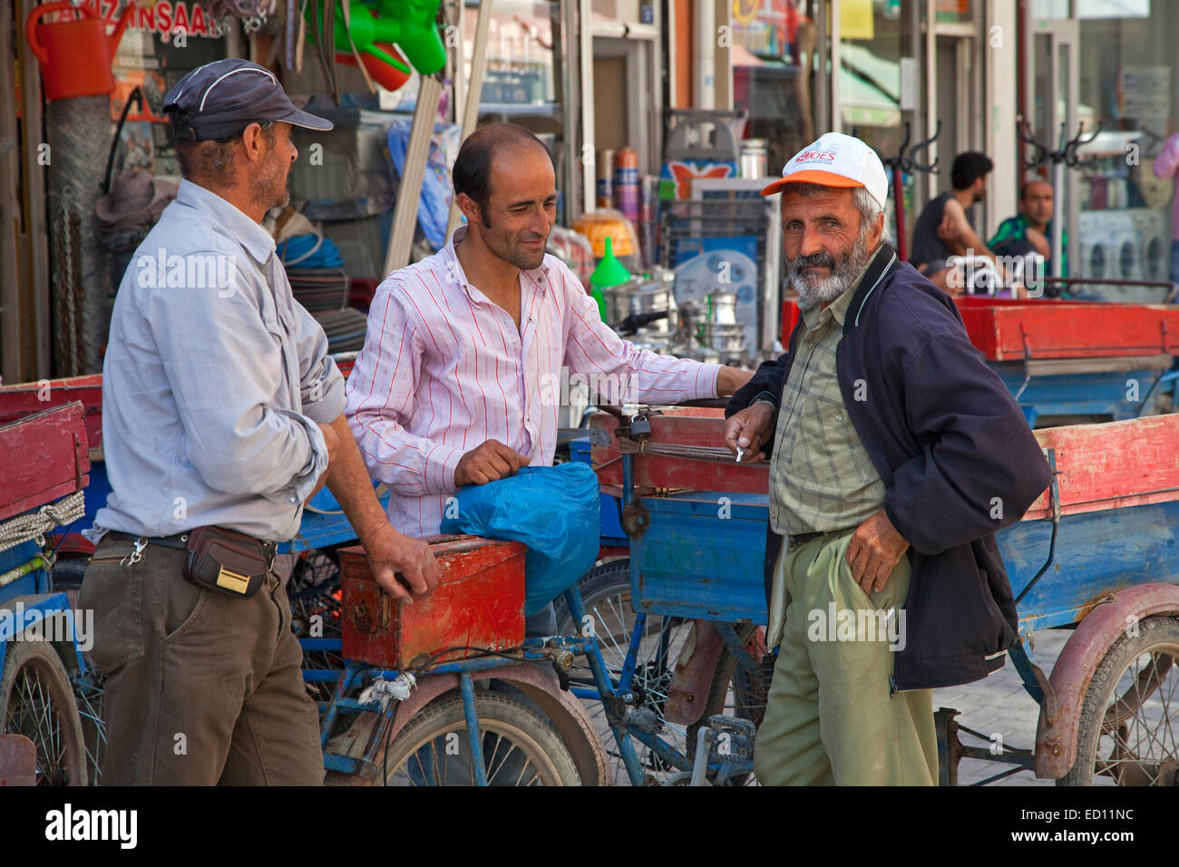 Turkish men chatting in a shopping street in the city Van, Eastern Turkey Stock Photo