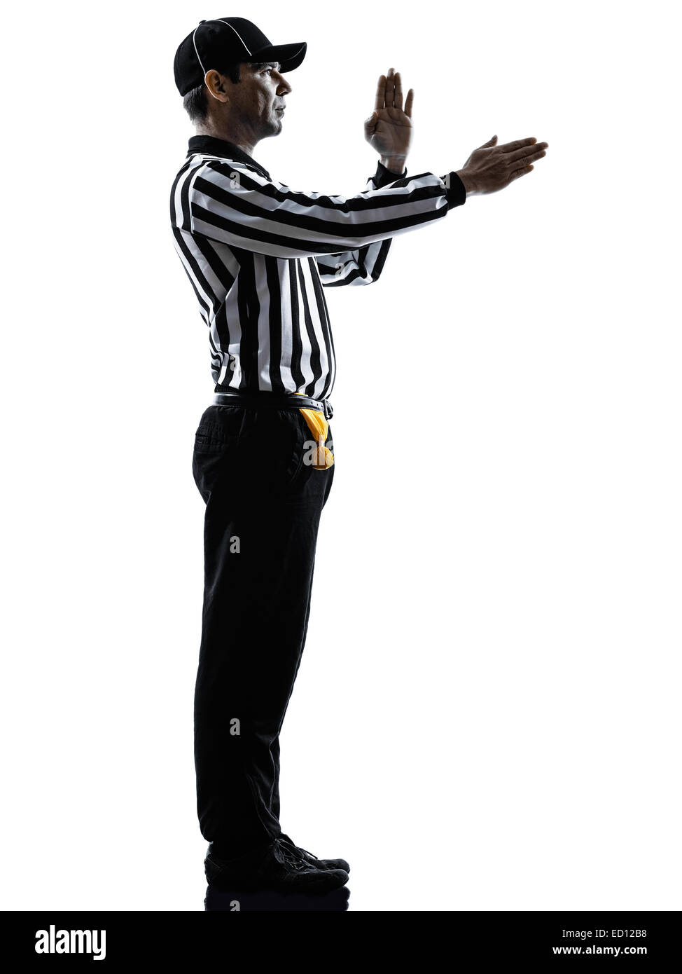 american football referee gestures in silhouette on white background - Stock Image