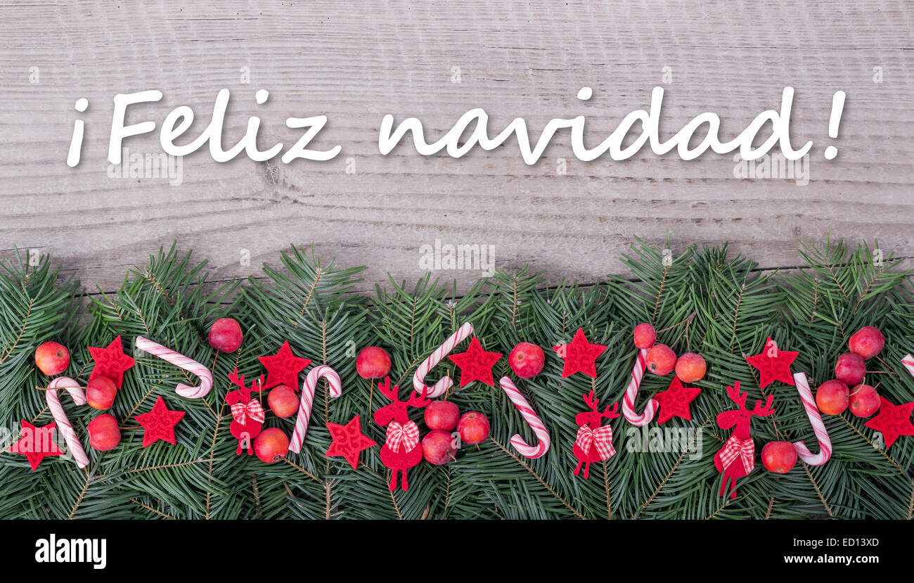 spanish Christmas card with Pine green, candy Canes, apples and text ...