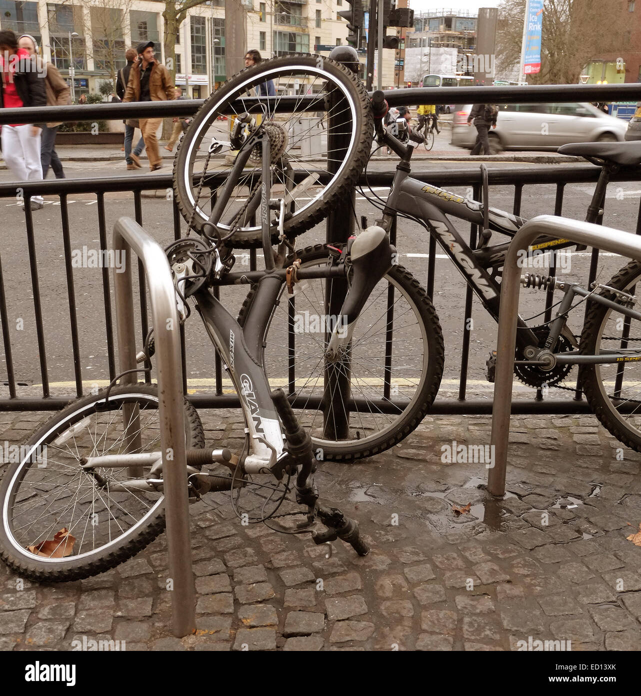 Badly parked bike in the centre of Bristol, locked secure 23rd December 2014 - Stock Image