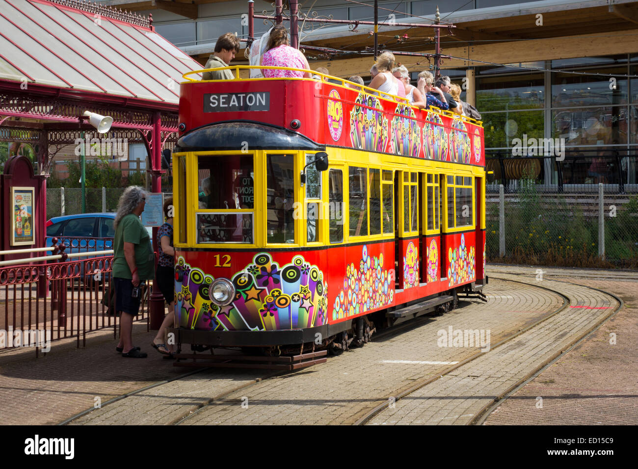 The Seaton electric tram at the station letting on more tourists to go on a jounrey around the town - Stock Image