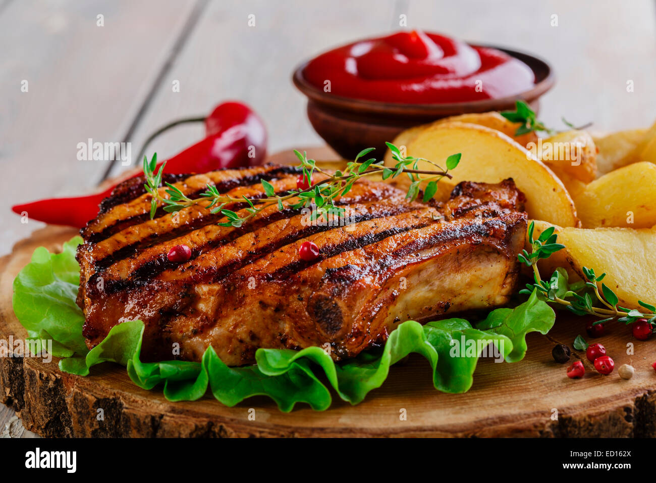 Grilled steak on the bone with potatoes Stock Photo