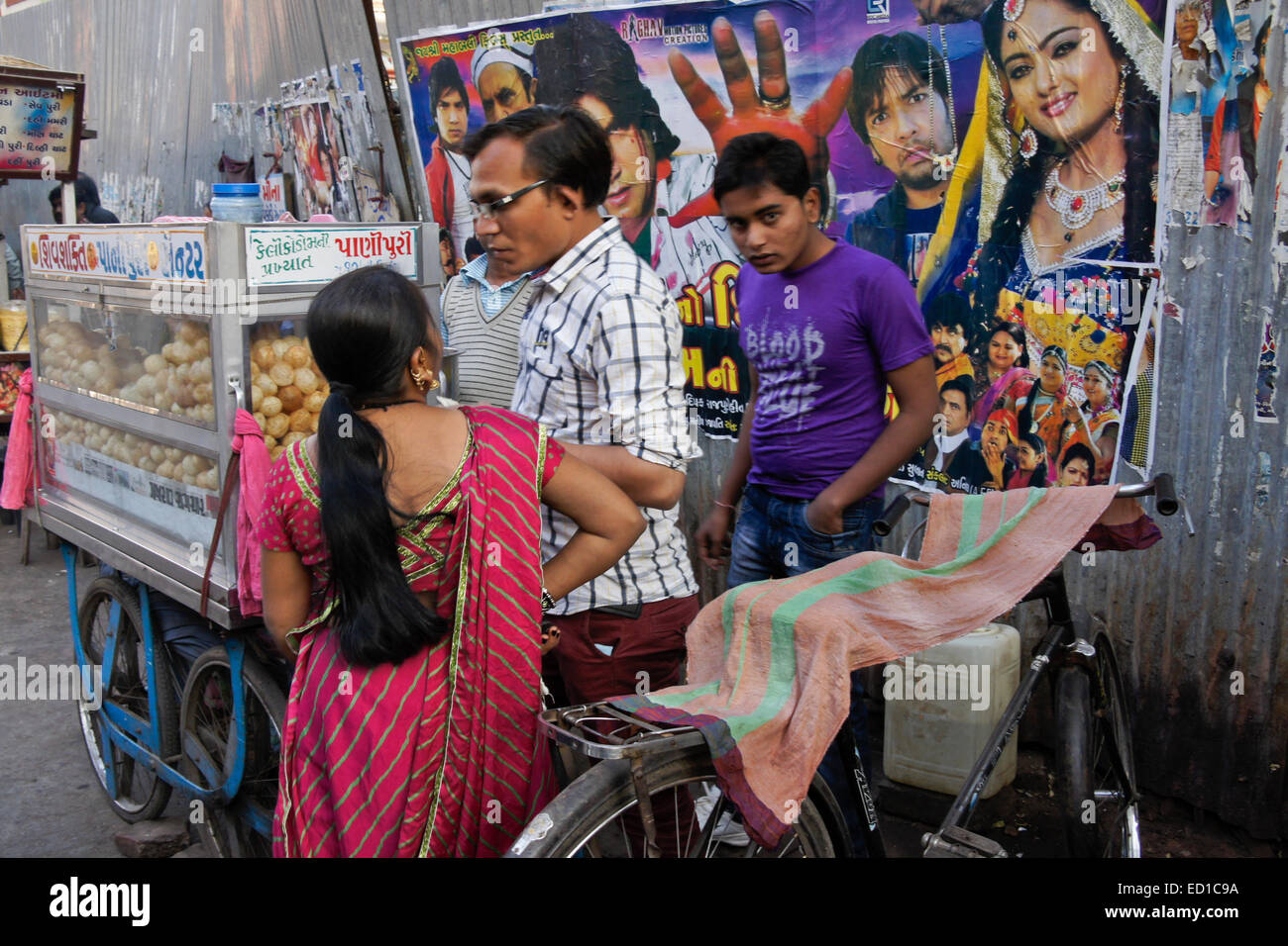 Street vendor and movie posters in Old Ahmedabad, Gujarat, India - Stock Image
