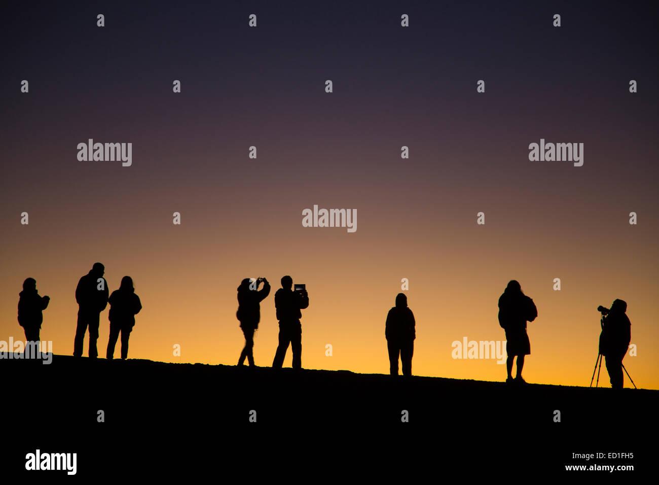 Visitors watching the sunset and stars from near the top of Haleakala, Haleakala National Park, Maui, Hawaii. - Stock Image