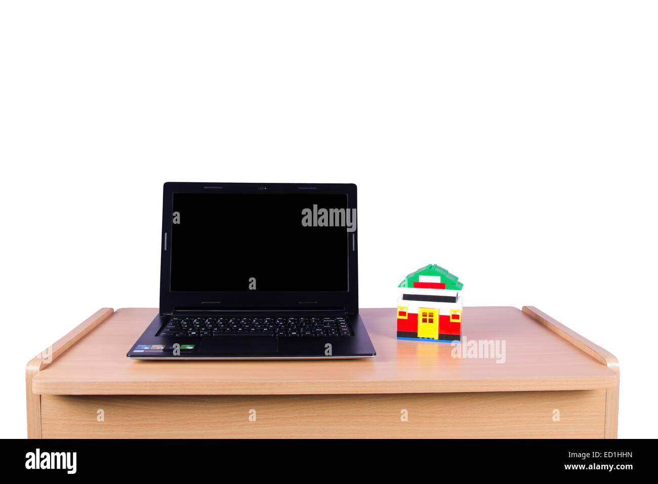 Modern Technology laptop and dummy house nobody - Stock Image