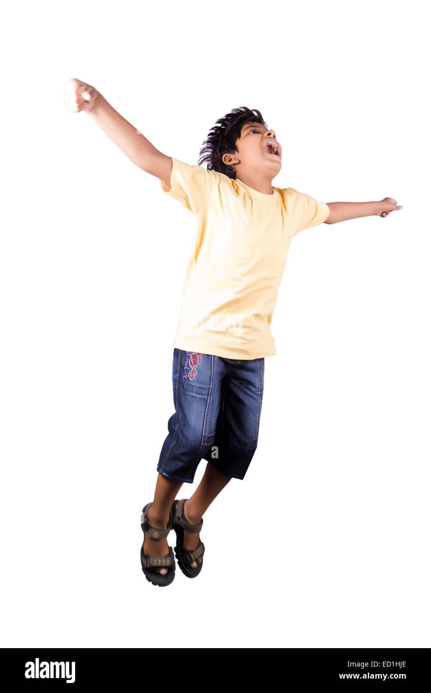 1 indian child boy jumping - Stock Image