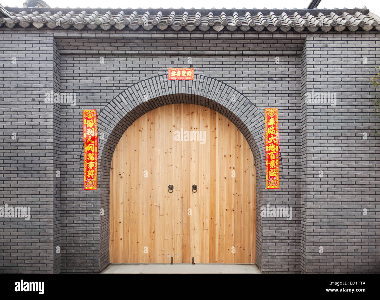 Chinese Traditional Door With An Red Antithetical Spring Couplet For New Year