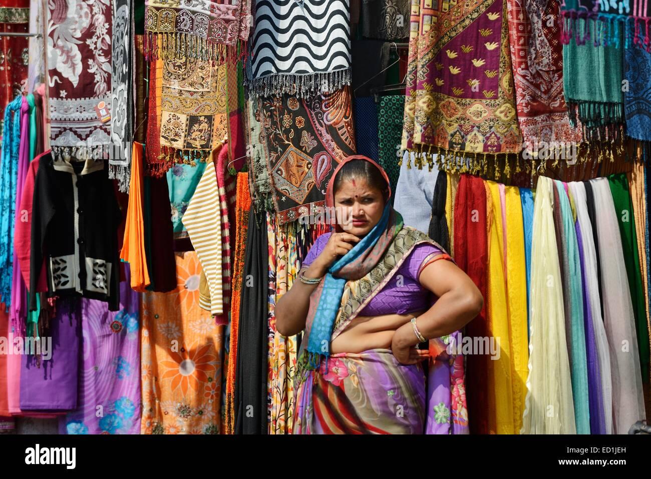 af4b987f66 India, Rajasthan, Mewar region, Bundi village, woman selling saris in a shop