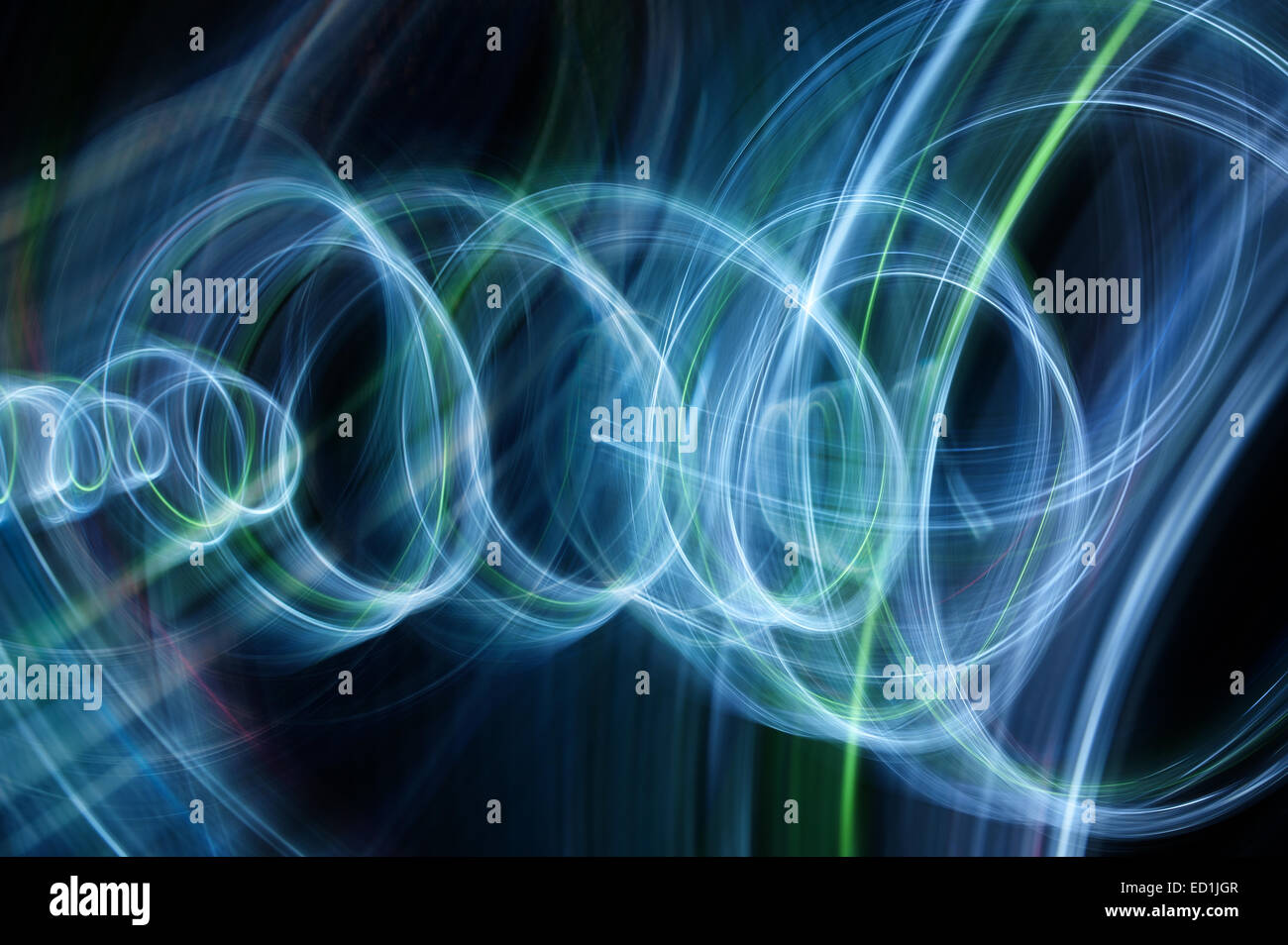 swirling spinning motion and trails traces of moving lights creating patterns vortice - Stock Image