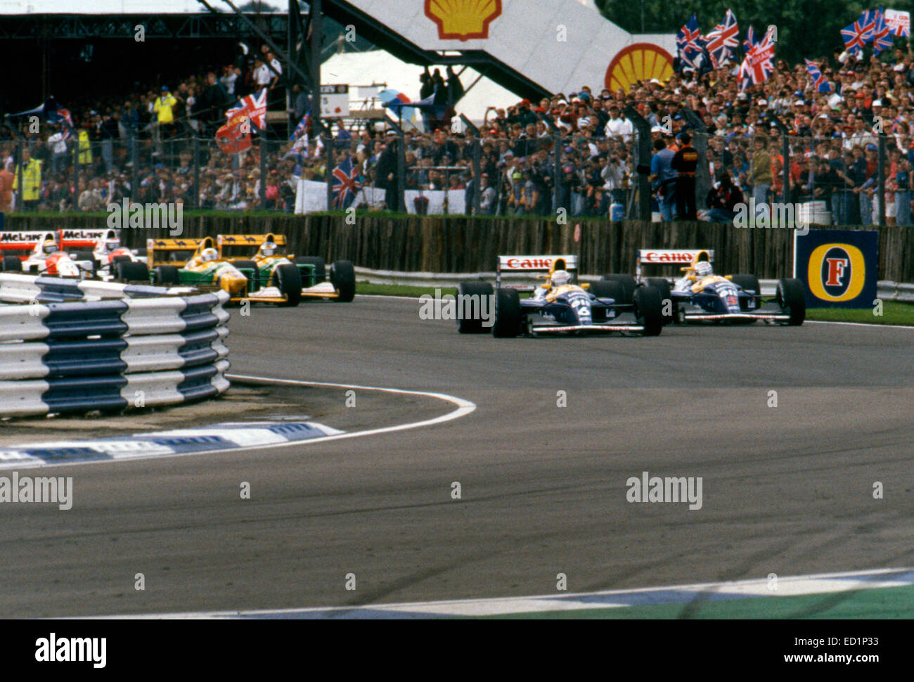 1992 British Grand Prix, Silverstone. Patrese leads Mansell in their Williams FW14B into Copse, 1st lap. - Stock Image