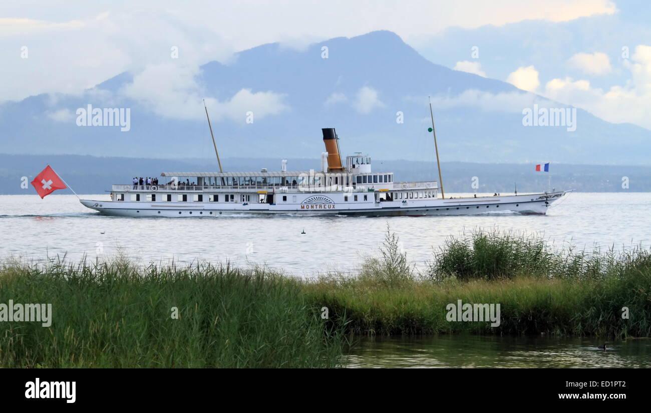 "GENEVA, SWITZERLAND - AUGUST 8 : old steamboat ""Montreux"" floating on Geneva lake, Switzerland, Augut 8, 2013. Stock Photo"