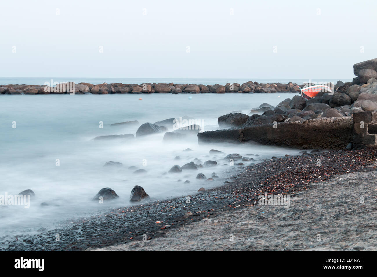 Silky Water in Torre Archirafi little village in east Sicily - Stock Image