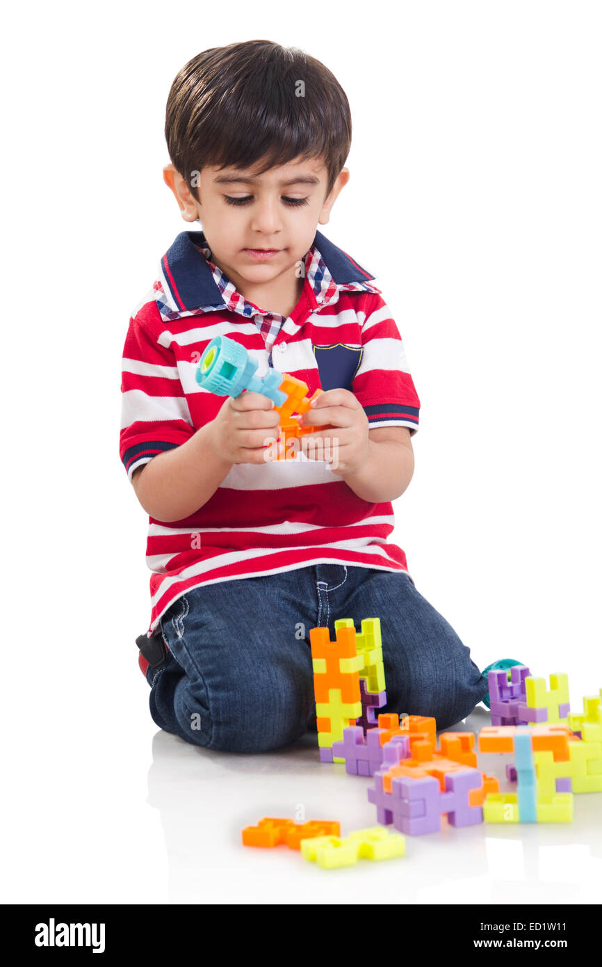 1 indian child boy playing toy - Stock Image