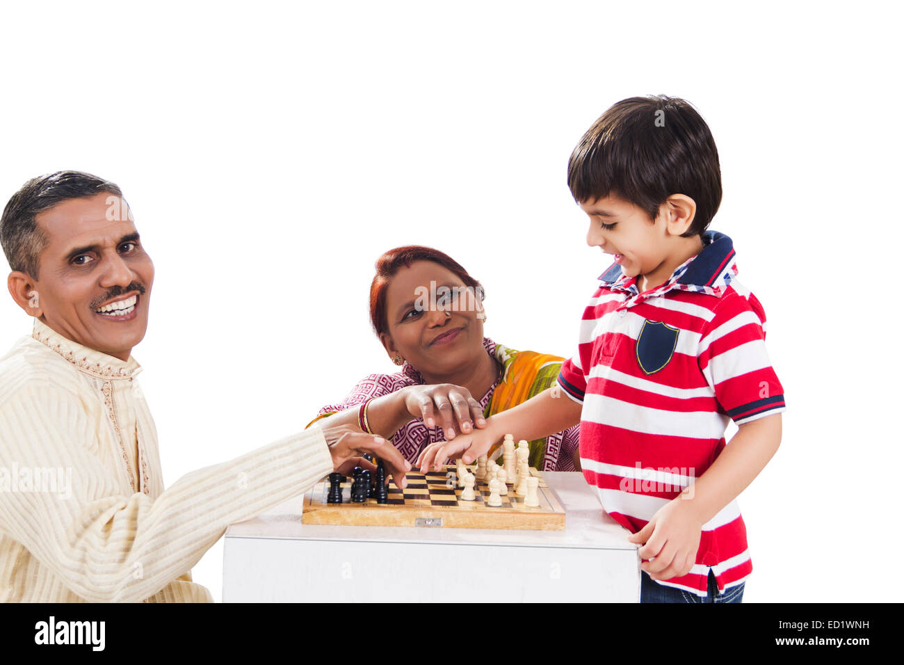indian Parents and grandson playing Chess Board - Stock Image
