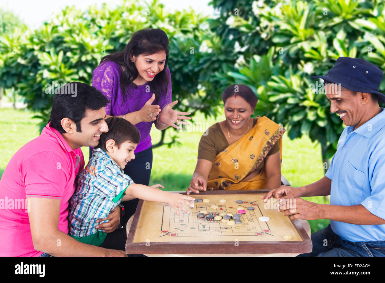 indian Joint Family group park playing Carrom Stock Photo