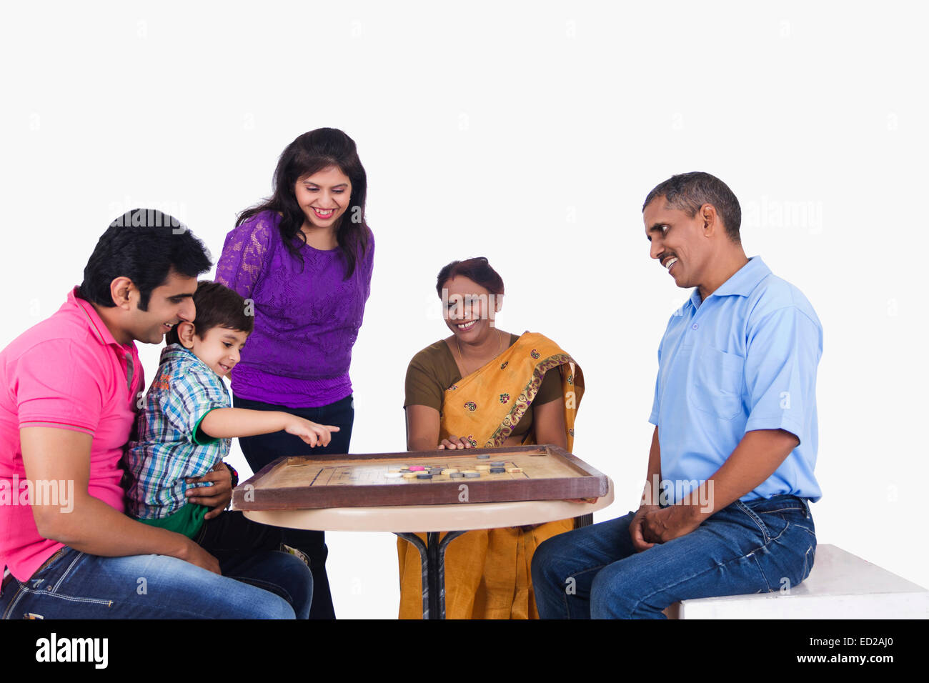 indian Joint Family group playing Carrom Stock Photo