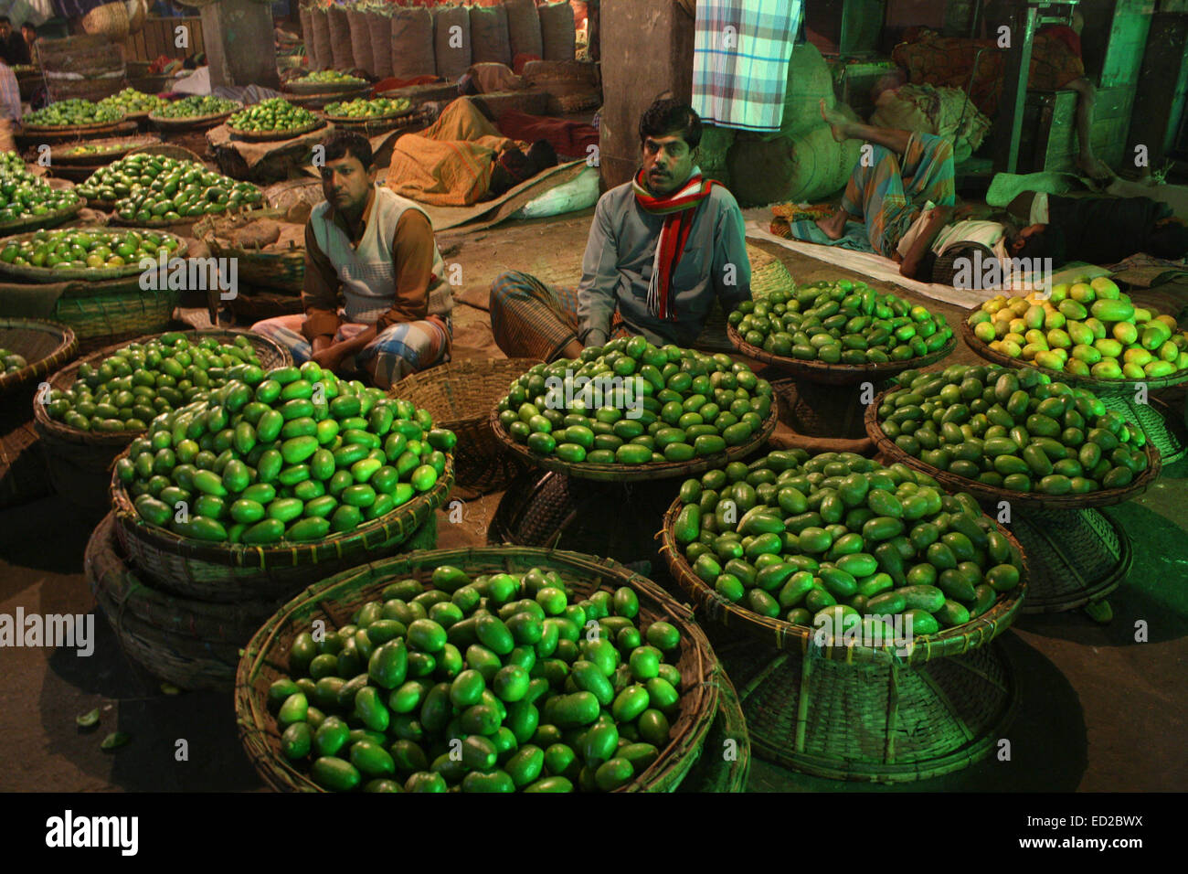 Bangladeshi lemon's vendor he waits for customers at a wholesale market at karwan Bazar in Dhaka on December - Stock Image