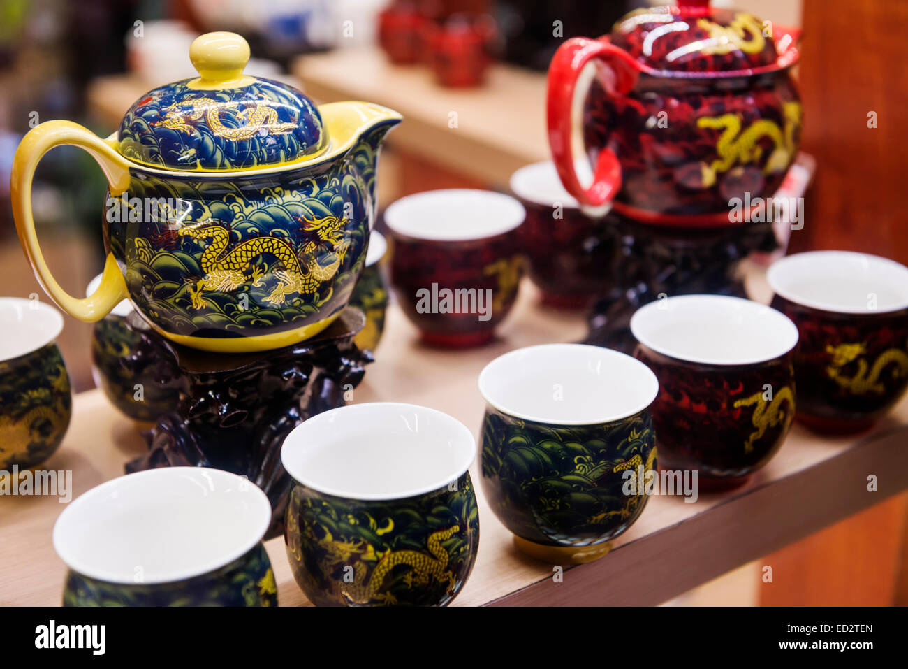 Chinese tea sets, painted decorative teapots and cups on display at a store in Shanghai, China - Stock Image