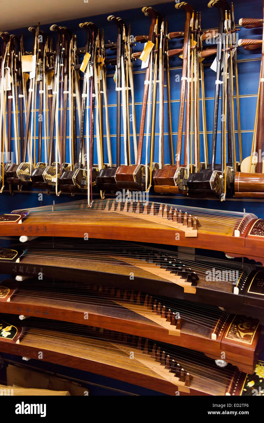 Guzheng, Chinese zither, and Erhu, Chinese fiddle, musical instruments in a store in Shanghai, China. - Stock Image