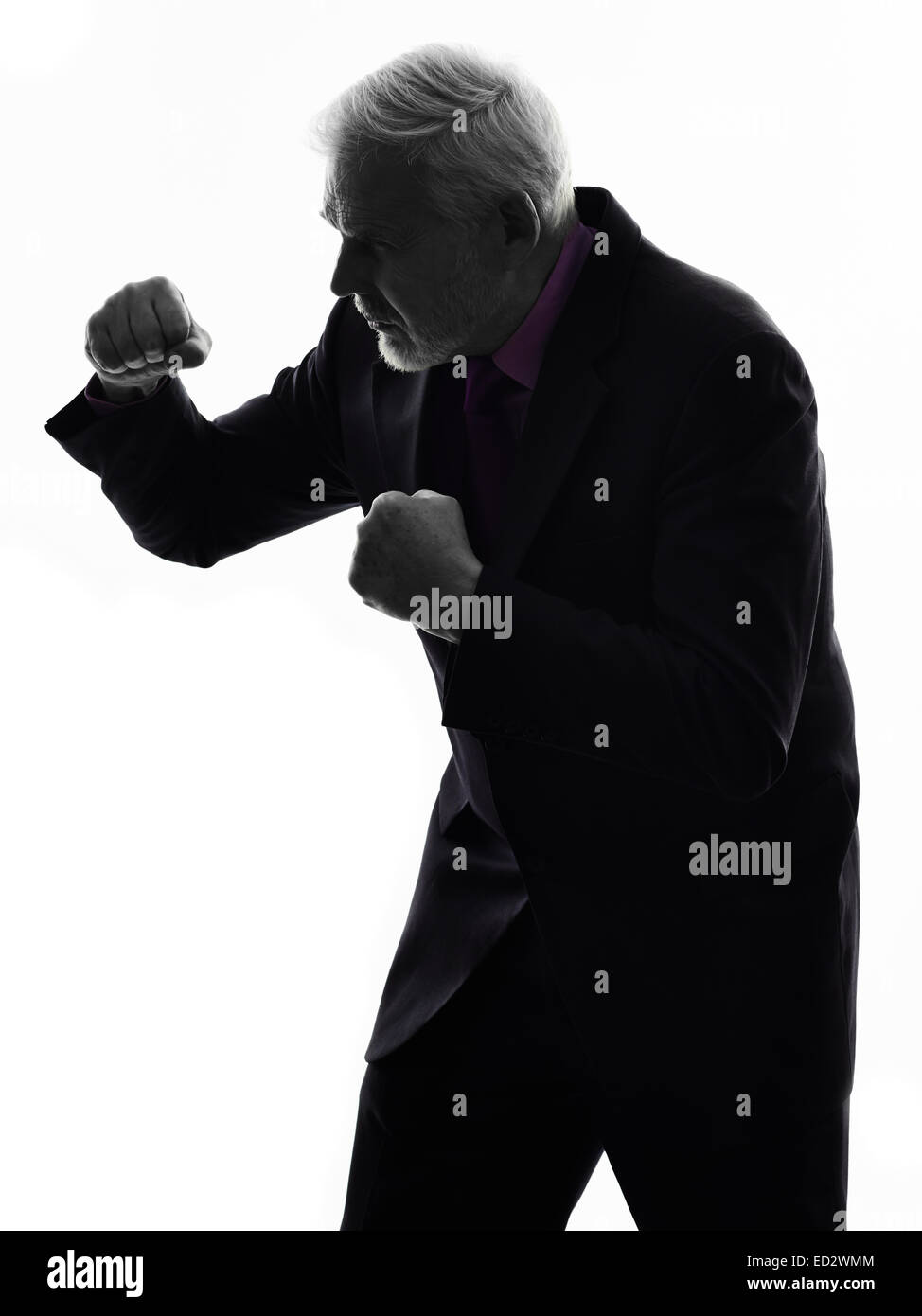 One Caucasian Senior Business Man punching the air Silhouette White Background - Stock Image