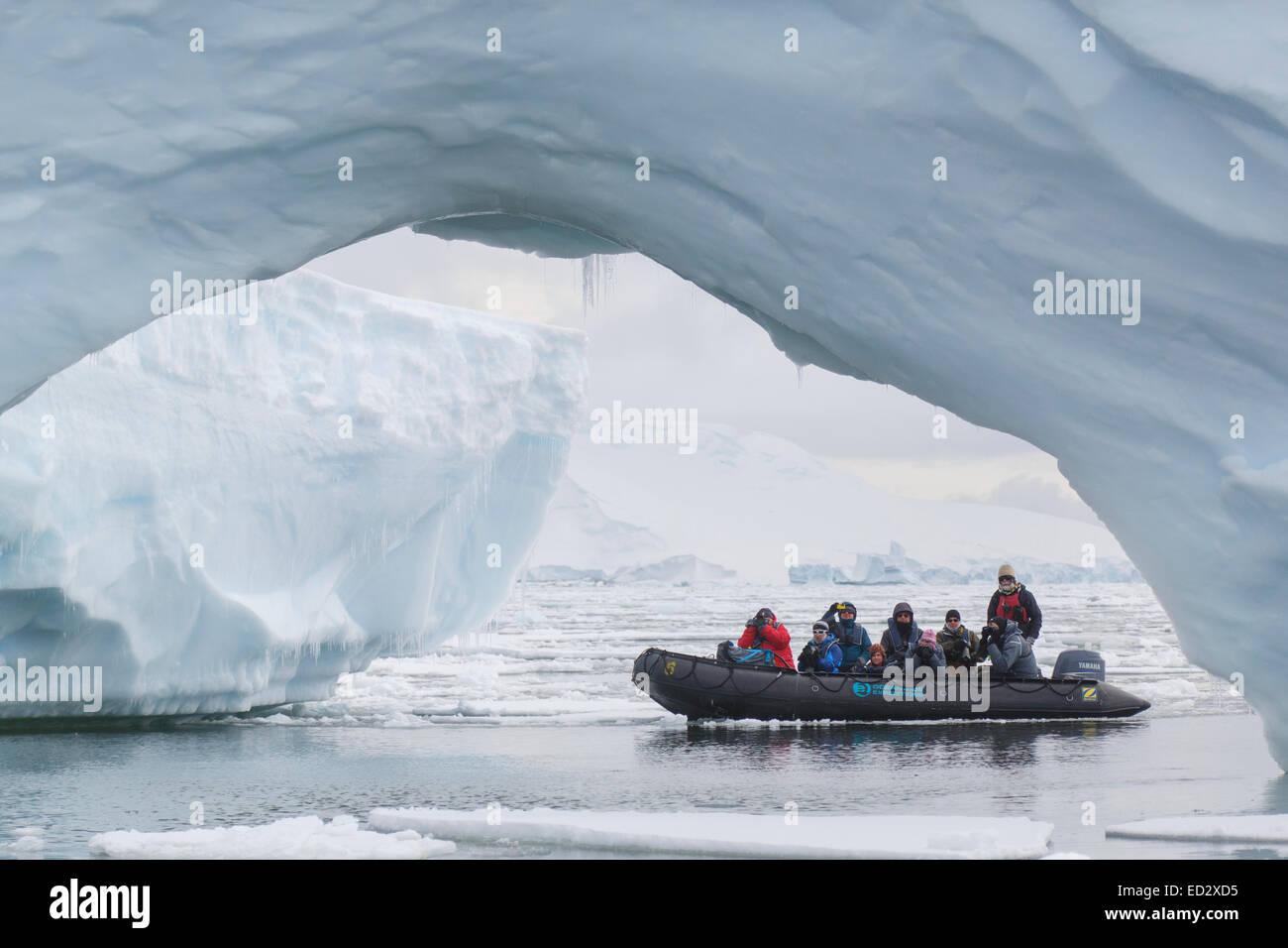 Zodiac cruising around Yalour Island, Antarctica. - Stock Image