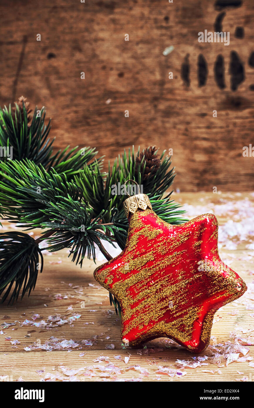 old-fashioned Christmas toy on the background of fir-tree branches ...