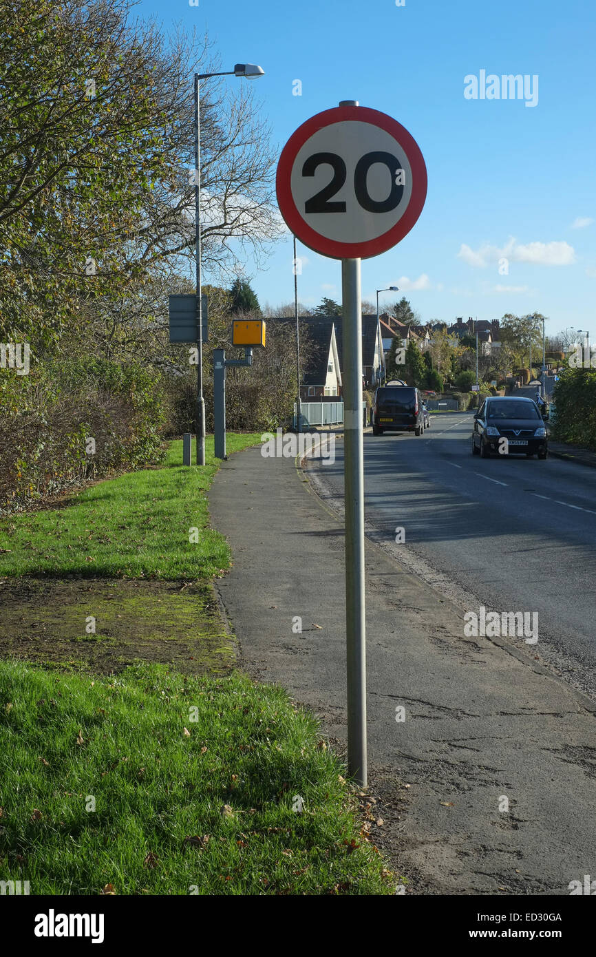 20 mph speed limit sign with speed camera - Stock Image