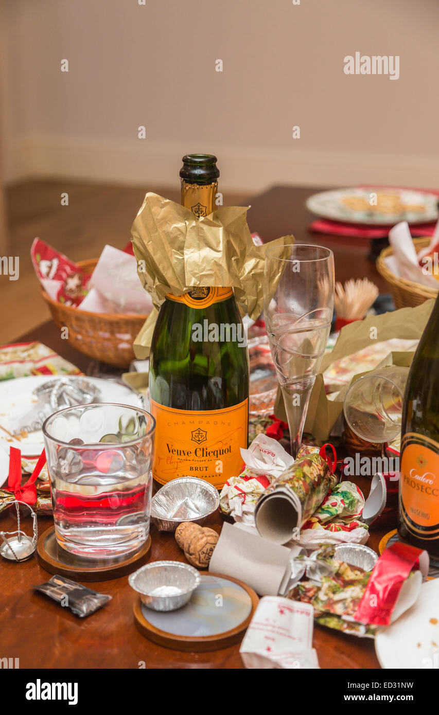Debris in the aftermath of a festive season party with an empty Veuve Clicquot champagne bottle and other rubbish Stock Photo