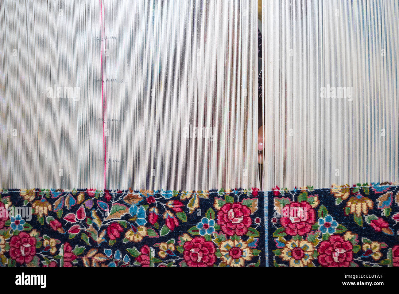Carpet weaving, city of Ravar, Kerman, Iran - Stock Image