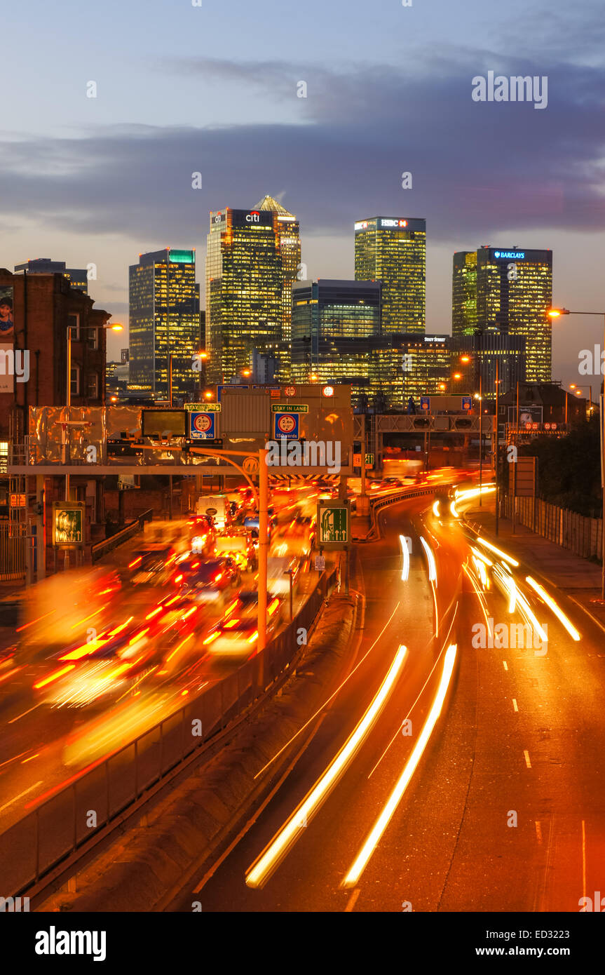 Traffic on A102 Blackwall Tunnel Approach with Canary Wharf skyscrapers in the background, London England United - Stock Image