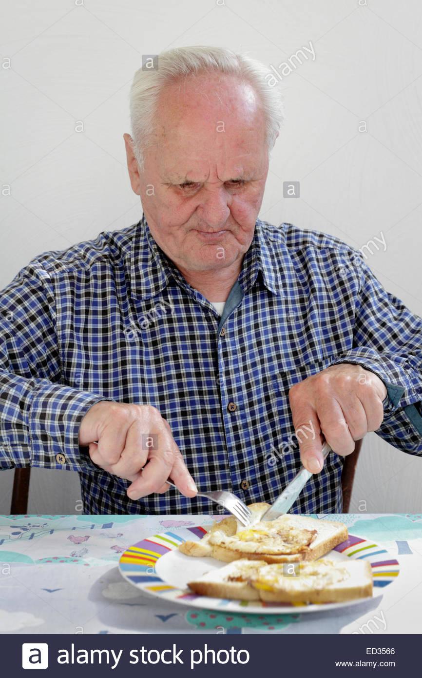 Old Man Eating Egg Stock Photos Amp Old Man Eating Egg Stock