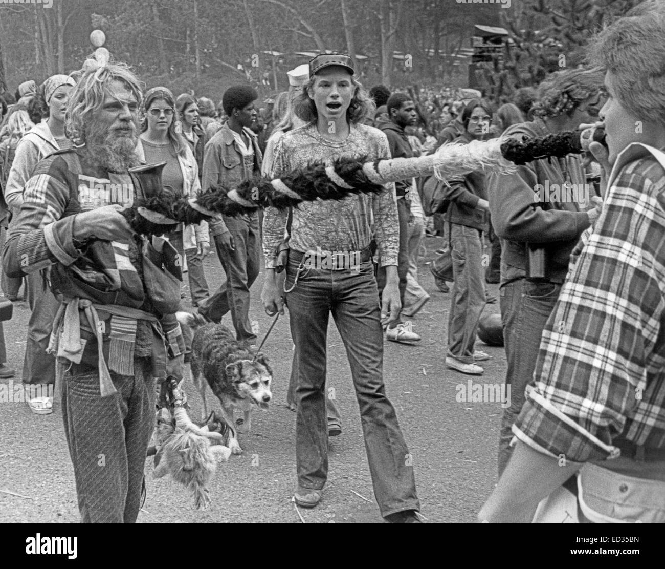 sharing a pipe at a free concert in Golden Gate Park, San Francisco, 1975 - Stock Image