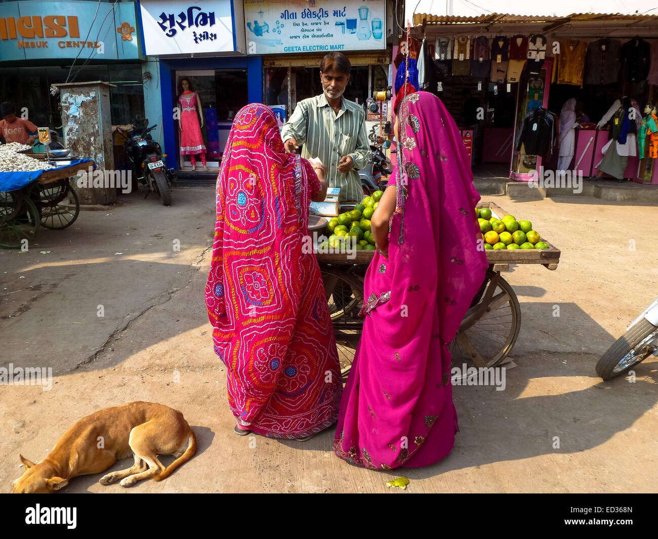 two women in colorful sari at the streets of bhuij gujarat india - Stock Image