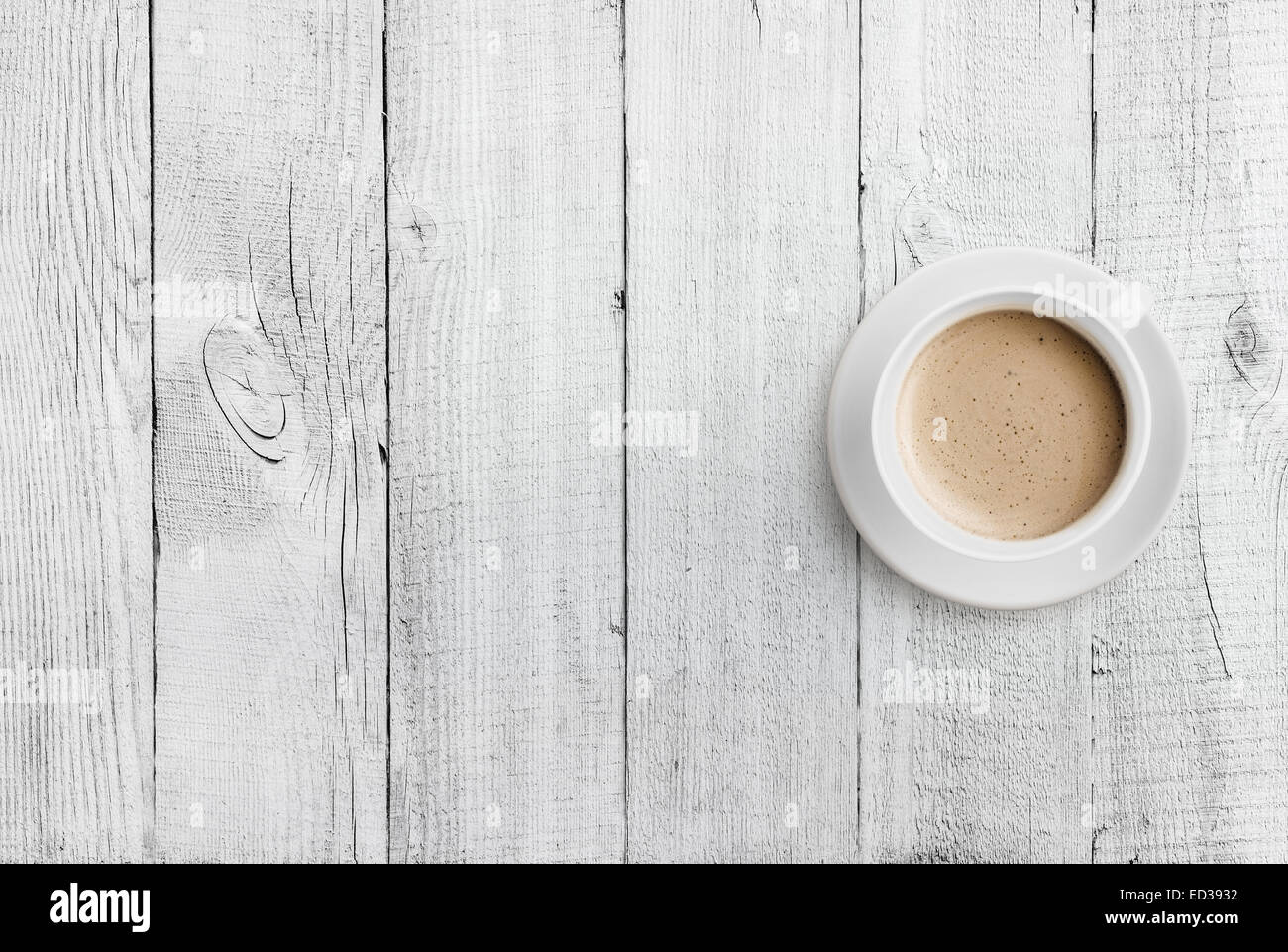 coffee cup top view on white wood table background - Stock Image