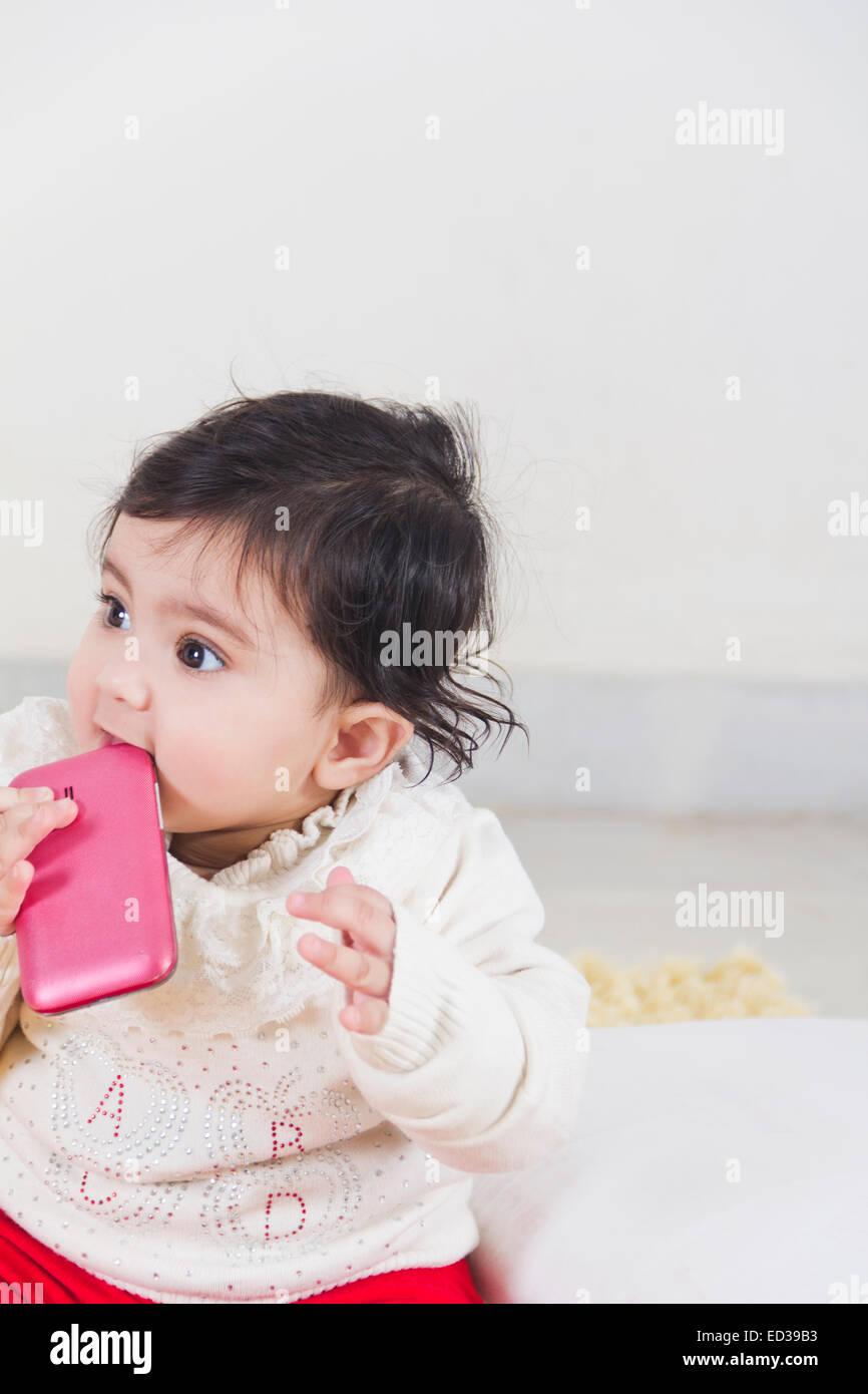 https://c8.alamy.com/comp/ED39B3/1-indian-child-baby-playing-cell-phone-ED39B3.jpg
