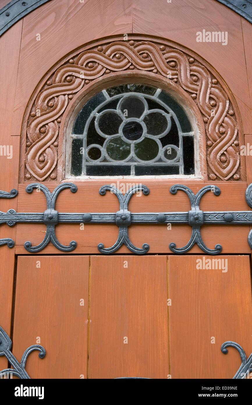 Leaded window in church door. From the Nordic stave church in Hahnenklee Germany & Leaded window in church door. From the Nordic stave church in Stock ...