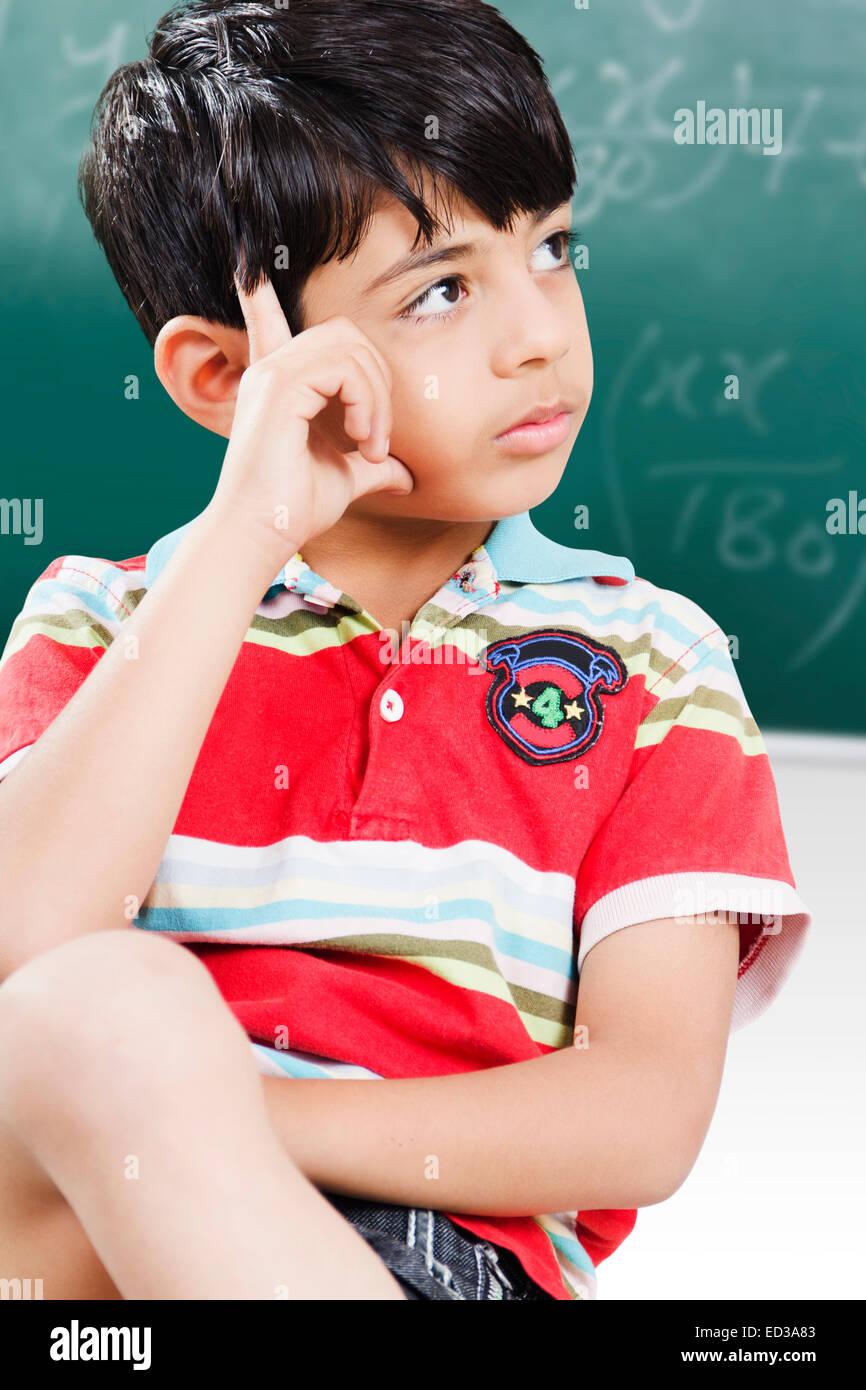 i indian child Student Thinking - Stock Image