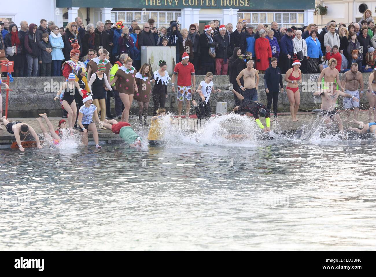Weymouth, Dorset, UK. 25 December 2014:  Thousands of spectators watched over 200 Swimmers take part in the 67th Stock Photo