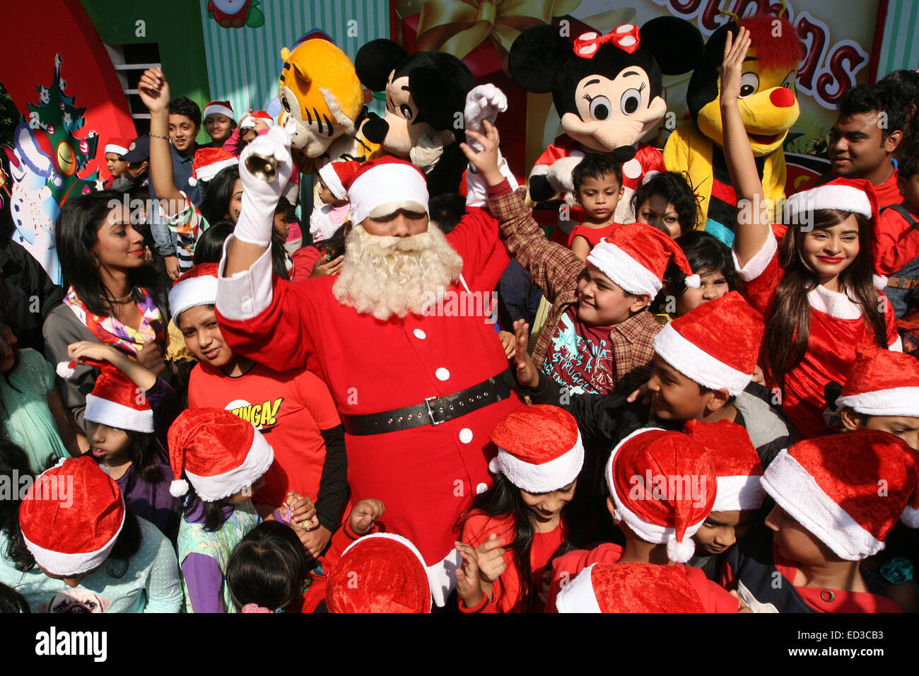 A Christmas Party.Santa Claus Poses With Bangladeshi Children For Photographs