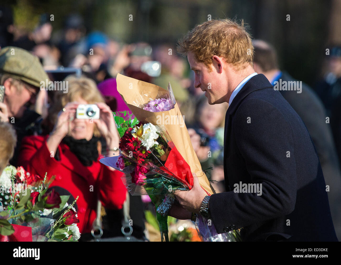 Sandringham, UK. 25th Dec, 2014.  Prince Harry attends the Christmas Service at St Mary Magdelene on the Sandringham - Stock Image