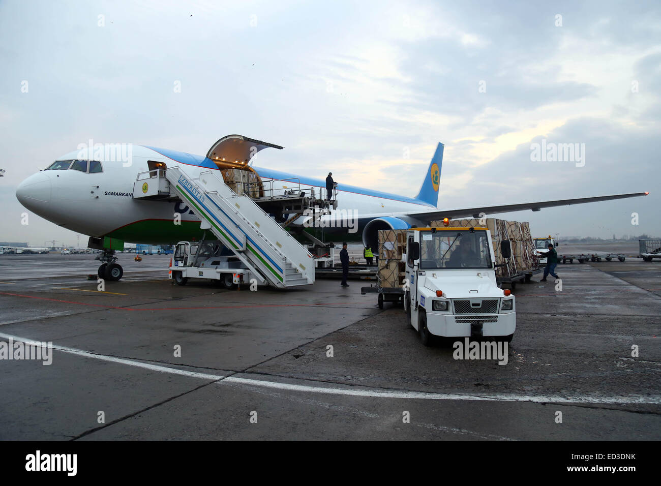 Tashkent. 25th Dec, 2014. A boeing 767 cargo charter of Uzbekistan Airways arrives at the airport of Tashkent, capital - Stock Image