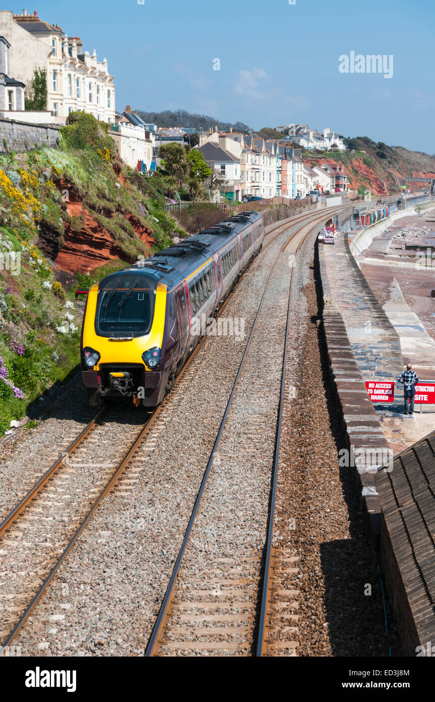 Voyager train of Cross Country Trains as it passes along the seawall at Dawlish - Stock Image