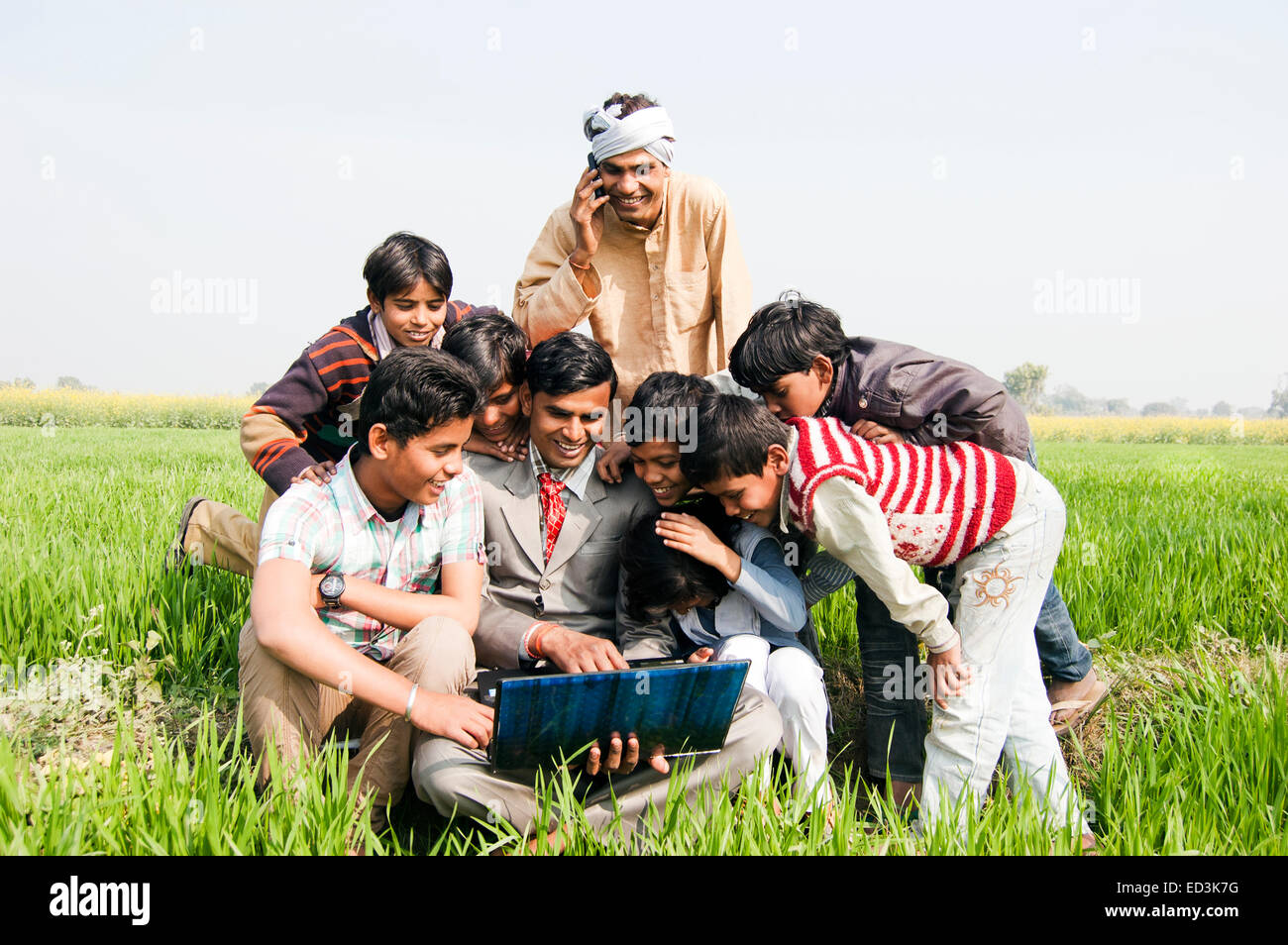 indian rural  Farmer family with Business Man laptop working - Stock Image