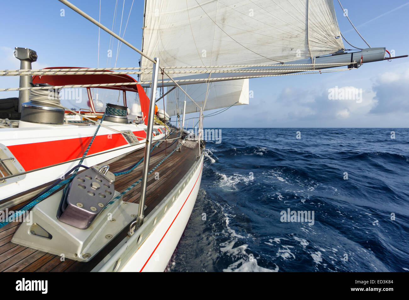 sail boat navigating on the waves - Stock Image