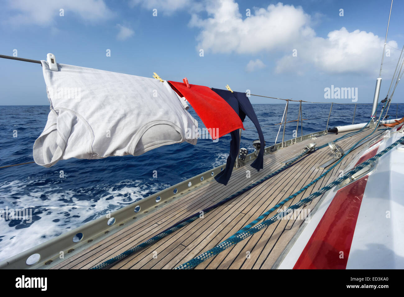 funny hanging clothes on the sail boat - Stock Image