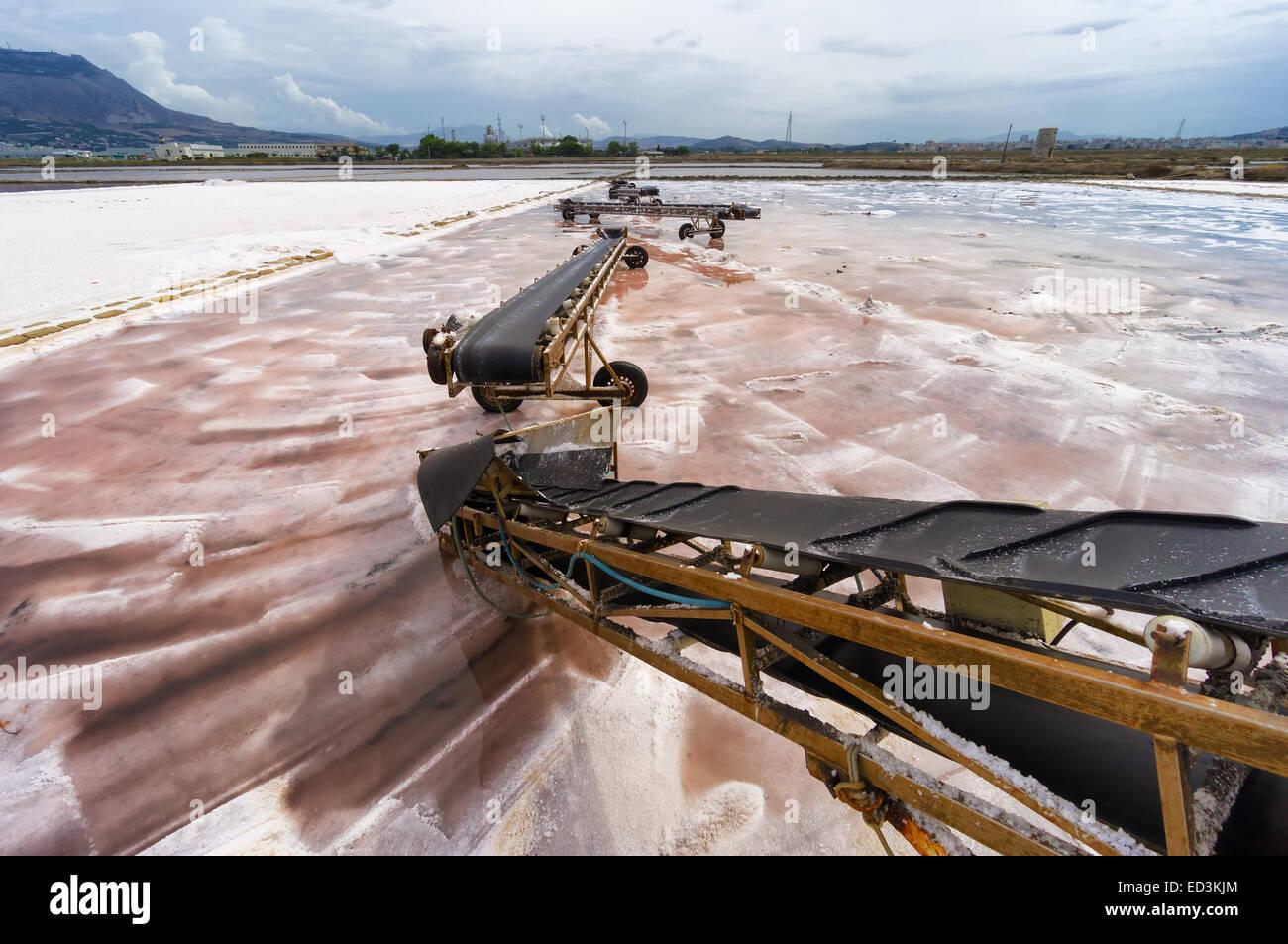 Sicily: conveyor belt on salt pan in Trapani, Italy - Stock Image
