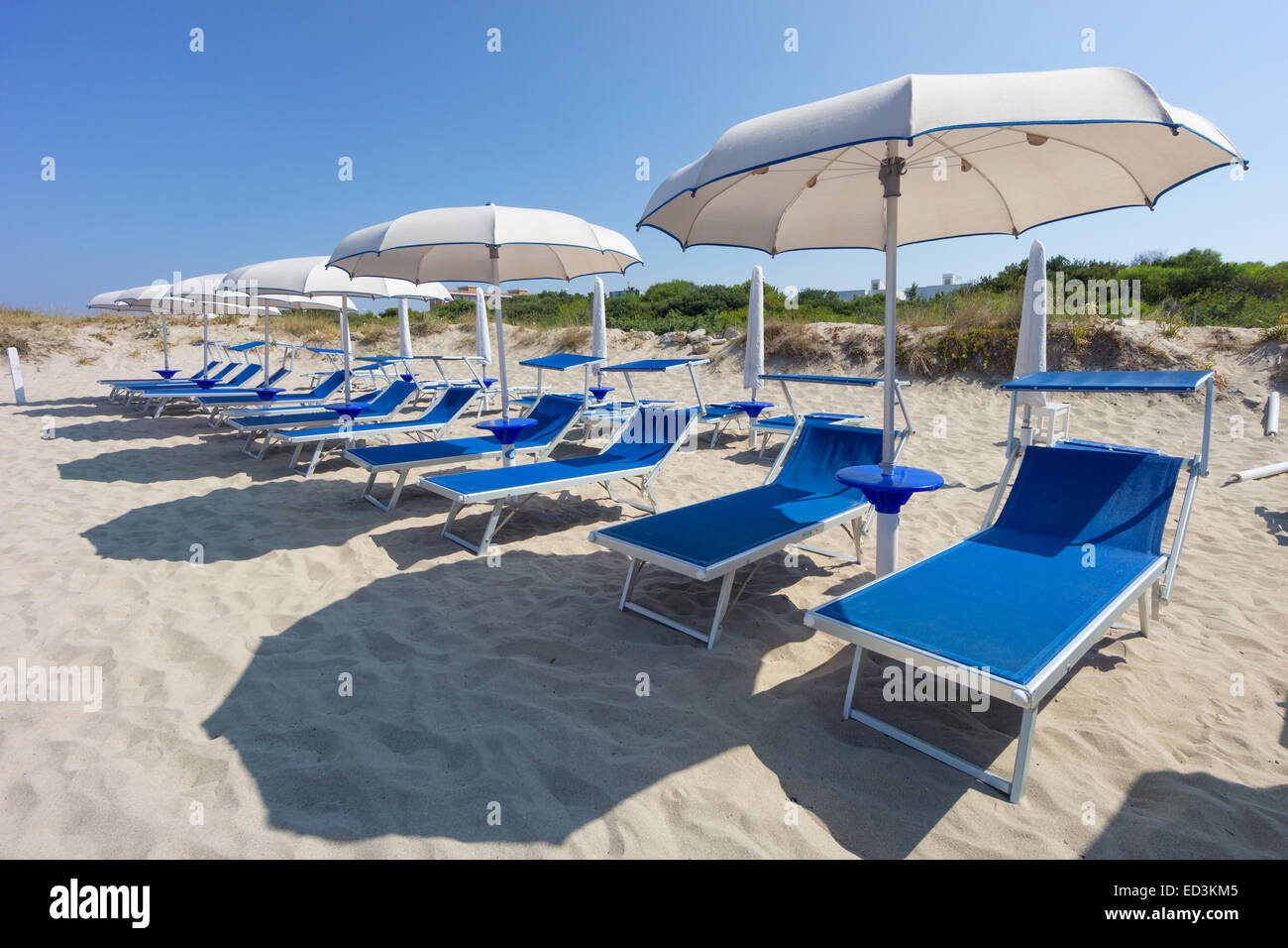 sunbeds and beach ubrellas in Gallipoli, Apulia, Italy - Stock Image