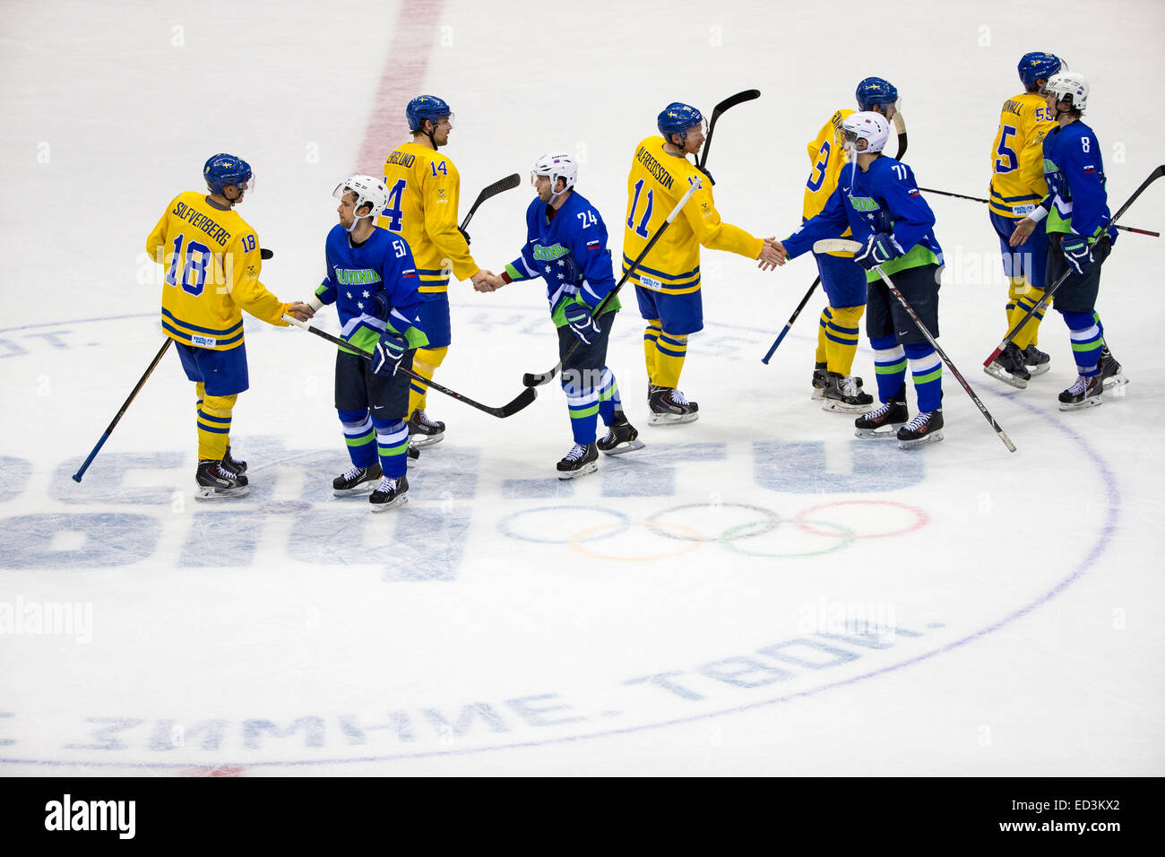 Team handshake at end of Sweden vs Slovenia game at the Olympic Winter Games, Sochi 2014 - Stock Image